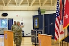 Maj. Patricia Cameron, U.S. Army Cadet Command, delivers her rendition of the National Anthem at the start of the Women's Equality Day Observance at Sadowski Center on Fort Knox, Kentucky, Aug. 23.