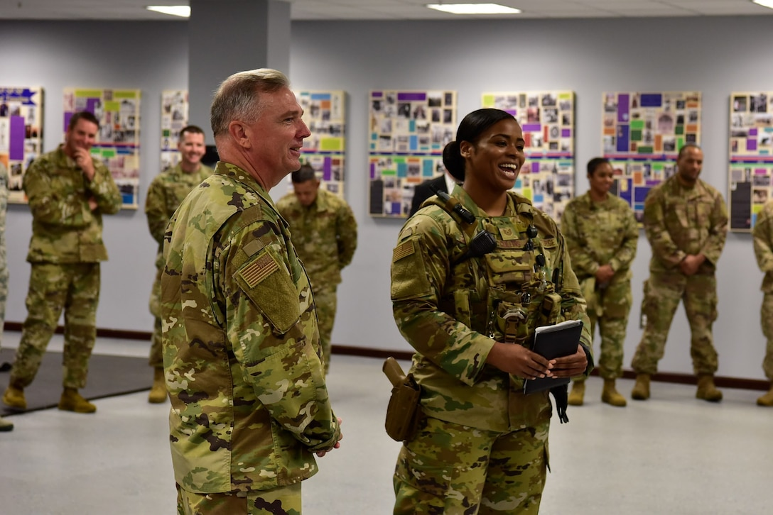 Air Force District of Washington Commander Maj. Gen. Ricky N. Rupp shares a light-hearted moment with Airmen from the 11th Security Forces Squadron during his wing immersion Aug. 20.