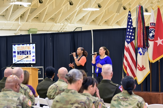 "Tanya Brown and Shawnien Moore sing ""How He Loves Us"" during the Fort Knox Women's Equality Observance hosted at Sadowski Center, Fort Knox Kentucky, Aug. 23."