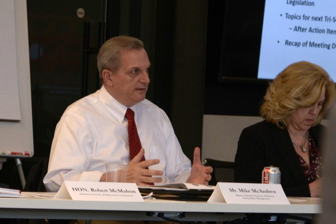 Man on panel speaks.