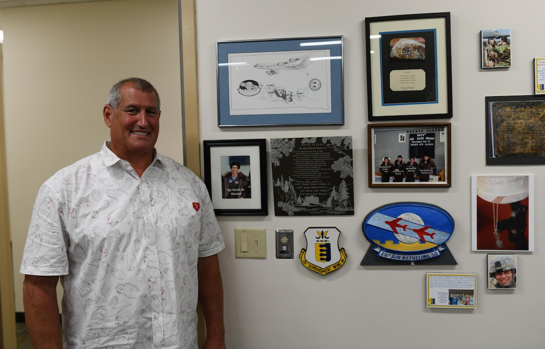 Jeff Wandel visits the memorial plaque that was dedicated to his brother, Sgt. David Wandel, a 28th Air Refueling Squadron boom operator, at the headquarters building on Ellsworth Air Force Base, S.D., July 30, 2019. After the 28th ARS was inactivated, the memorial was moved and Jeff spent several years trying to track it down. Eventually, the plaque was found in the South Dakota Air and Space Museum's inventory. (U.S. Air Force photo by Airman 1st Class Christina Bennett)
