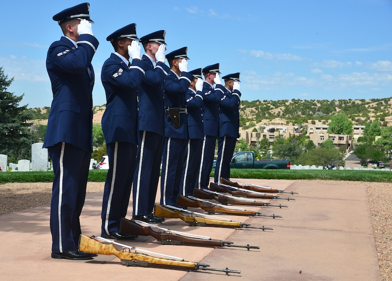 Members of the Kirtland Air Force Base Honor Guard salute the remains of U.S. Navy Fireman First Class Billy James Johnson at the Santa Fe National Cemetery in Santa Fe, N.M. Aug. 19, 2019. Johnson was amongst 429 crewmembers of the USS Oklahoma who lost their lives when the battleship came under surprise attack and completely sunk at Pearl Harbor Dec. 7, 1941. (U.S. Air Force photo by Airman 1st Class Austin J. Prisbrey)
