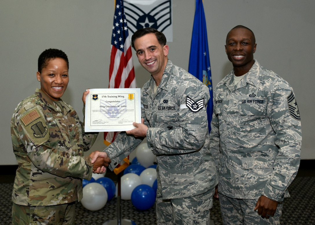 U.S. Air Force Staff Sgt. select Johnathan Vetter, 17th Security Forces Squadron, receives his promotion certificate during the staff sergeant release party at the event center on Goodfellow Air Force Base, Texas, August 23, 2019. Staff sergeants are highly trained technicians with supervisory and training responsibilities. (U.S. Air Force photo by Airman 1st Class Robyn Hunsinger/Released)