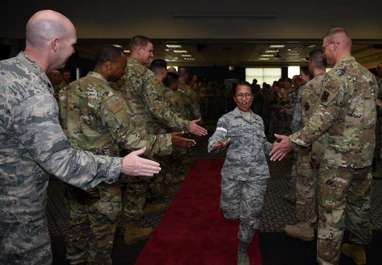 U.S. Air Force Staff Sgt. select Cleofe Jensen, 17th Force Support Squadron career development technician, runs down the gauntlet receiving high-fives during the staff sergeant release party at the event center on Goodfellow Air Force Base, Texas, August 23, 2019. The primary focus of the noncommissioned officer tier of the enlisted force structure is to continue occupational growth and to develop themselves and their troops while accomplishing the mission. (U.S. Air Force photo by Airman 1st Class Robyn Hunsinger/Released)
