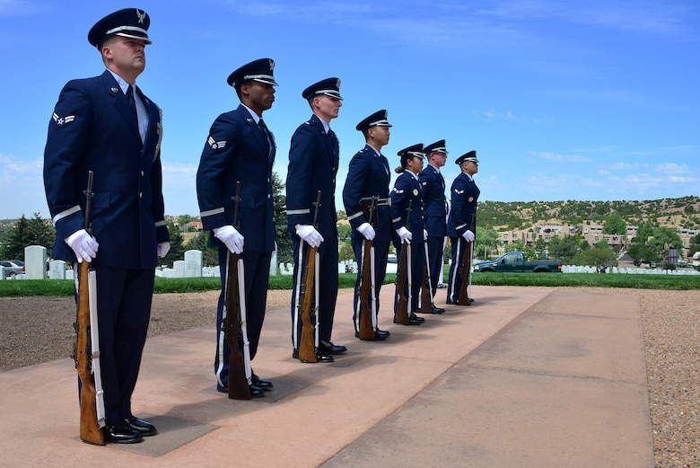 Members of the Kirtland Air Force Base Honor Guard stand at attention during a funeral ceremony for U.S. Navy Fireman First Class Billy James Johnson at the Santa Fe National Cemetery in Santa Fe, N.M. Aug. 19, 2019. Johnson was amongst 429 crewmembers of the USS Oklahoma who lost their lives when the battleship came under surprise attack and completely sunk at Pearl Harbor Dec. 7, 1941. (U.S. Air Force photo by Airman 1st Class Austin J. Prisbrey)