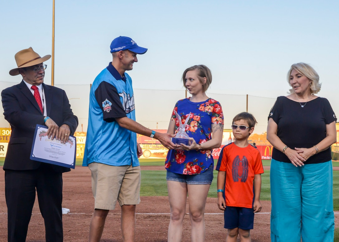 Tech. Sgt. Janna Ybarra, 412th Medical Group, receives the Bank of America/Merrill Military Service Before Self Award during a Lancaster JetHawks game at the Hangar baseball stadium in Lancaster, California, Aug. 24. (U.S. Air Force photo by Giancarlo Casem)