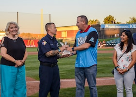 Lead Firefighter James Levell, 812th Civil Engineer Squadron, receives the Bank of America/Merrill Military Service Before Self Award during a Lancaster JetHawks game at the Hangar baseball stadium in Lancaster, California, Aug. 24. (U.S. Air Force photo by Giancarlo Casem)