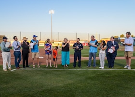 Tech. Sgt. Janna Ybarra, 412th Medical Group, and Lead Firefighter James Levell, 812th Civil Engineer Squadron (pictured with awards) are applauded after receiving the Bank of America/Merrill Military Service Before Self Award during a Lancaster JetHawks game at the Hangar baseball stadium in Lancaster, California, Aug. 24. (U.S. Air Force photo by Giancarlo Casem)