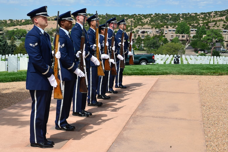 Members of the Kirtland Air Force Base Honor Guard present arms at a funeral ceremony for U.S. Navy Fireman First Class Billy James Johnson at the Santa Fe National Cemetery in Santa Fe, N.M. Aug. 19, 2019. Technological advances with mitochondrial DNA allowed his primary next of kin to provide a DNA sample which lead to positive identification of Johnson. Of the 429 Sailors that lost their lives when the USS Oklahoma was sunk in the attack on Pearl Harbor, only 35 were later positively identified with this advance technology. (U.S. Air Force photo by Airman 1st Class Austin J. Prisbrey)