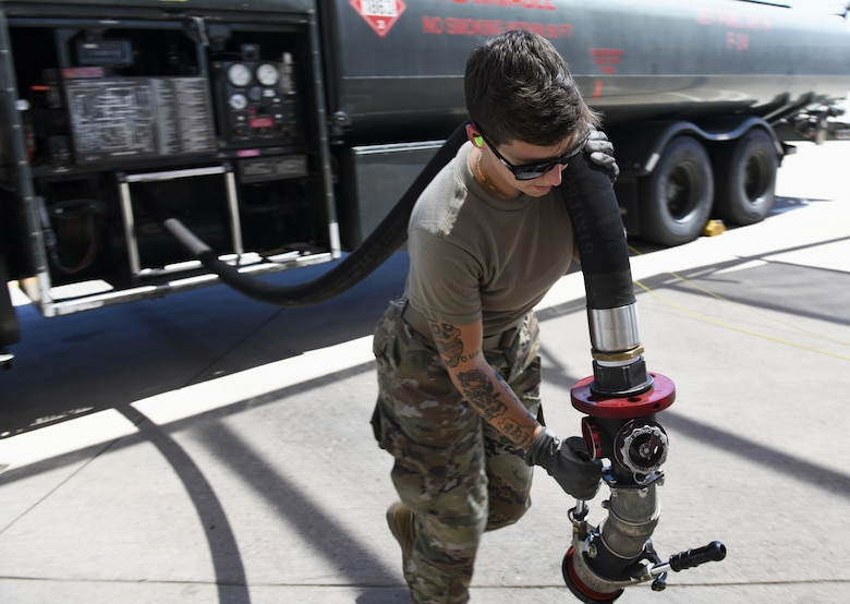 Airman 1st Class Katlynn Masnyk, 56th Logistics Readiness Squadron distribution fuels operator, pulls out a fuel hose to fuel an F-35A Lightning II Aug. 21, 2019, at Luke Air Force Base, Ariz.