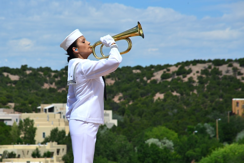 U.S. Navy Information Specialist First Class Monica Lujan, Navy Operational Support Center Albuquerque, plays taps at a funeral ceremony for U.S. Navy Fireman First Class Billy James Johnson at the Santa Fe National Cemetery in Santa Fe, N.M. Aug. 19, 2019. Johnson was the son of William Gould Johnson and Zelah Adeline Dodson. He was one of eight children, born Nov. 24, 1919 in Caney, Ky. Johnson spent his teenage years in Chama, N.M. (U.S. Air Force photo by Airman 1st Class Austin J. Prisbrey)