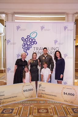 Tessa, key spouse for the 42nd Attack Squadron, smiles for a photo with her family and the NMFA owners in Caesar's Palace at Las Vegas, Nevada for the presentation of her checks, July 20, 2019. Tessa is pursuing her degree through Clemson University online. (Courtesy photo by: Lindsey Miller)