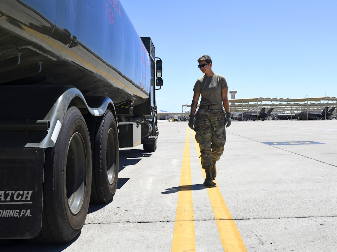 Airman 1st Class Katlynn Masnyk, 56th Logistics Readiness Squadron fuels distribution operator, performs a foreign object debris check Aug. 21, 2019, at Luke Air Force Base, Ariz.