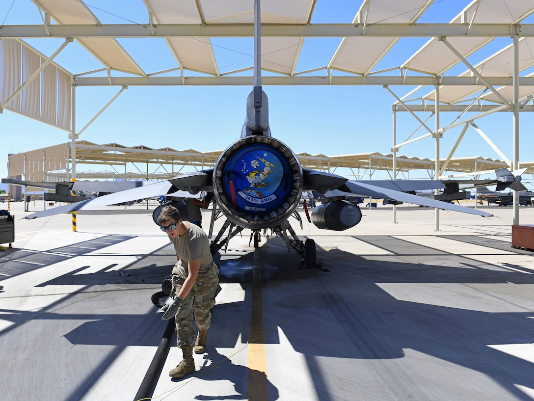 Airman 1st Class Katlynn Masnyk, 56th Logistics Readiness Squadron distribution fuels operator, drags a hose after she finishes refueling an F-16 Fighting Falcon from the 309th Fighter Squadron Aug. 21, 2019, at Luke Air Force Base, Ariz.
