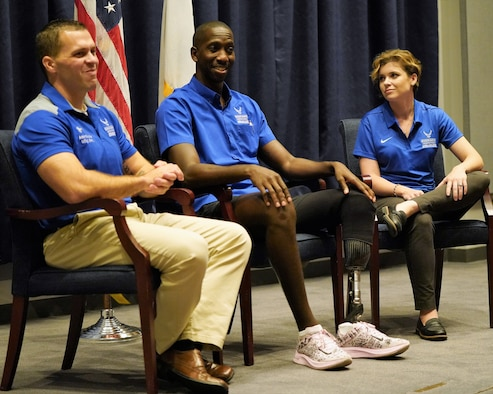 Three Air Force Wounded Warrior Program Ambassadors (pictured left to right), Master Sgt. (Ret.) Adam Boccher, Staff Sgt. Kevin Greene, and Maj. (Ret.) Emily Elmore, discuss their unique experiences on the road to recovery and resiliency during an event conducted at U.S. Transportation Command, Aug. 21.