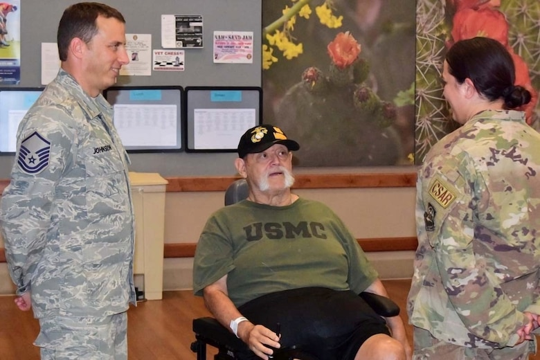 Airmen visit with Marine Veteran at Tucson Veteran's Administration Hospital