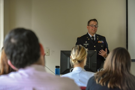 Dr. (Lt. Col.) Christian Schrader, Army psychiatrist and program director of Carl R. Darnell Army Medical Center's Psychiatry Residency, at Fort Hood, Texas, conducted a didactics lecture on Post Traumatic Stress Disorder for medical residents affiliated with Louisiana State University Health Science Center School of Medicine at Ochsner Medical Center, Kenner, Louisiana, Aug. 9. (Photo by Leanne Thomas)