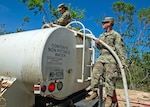 Soldiers of the Puerto Rico National Guard are working 24/7 to prepare for the landfall of Tropical Storm Dorian. This photo from October 2017 shows Soldiers working to filter water and provide it to those affected by Hurricane Maria.