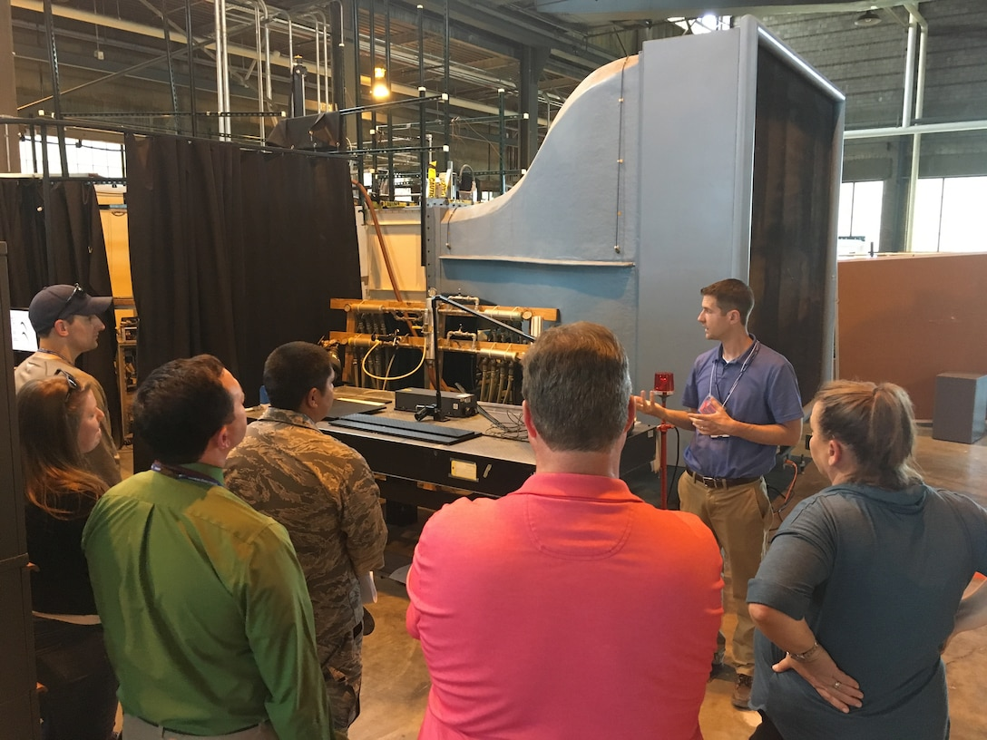 AFRL Aerospace Systems Directorate Aerospace Engineer Chris Marks explains the low speed cascade wind tunnel during the Aug. 19, 2019, Open House. This facility is used to gather data that impacts the efficiency, size, weight, and cost of future Air Force engines. (U.S. Air Force photo/Tim Bergeron)