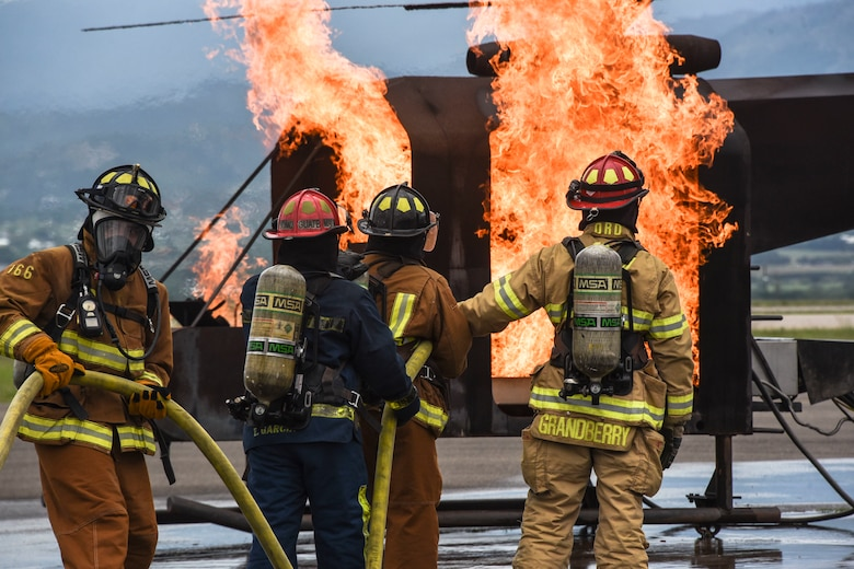 Firefighters from Joint Task Force-Bravo, 612th Air Squadron participated in aircraft-fire training with multinational partners at Soto Cano Air Base, Honduras, Aug. 21, 2019, during Central America Sharing Mutual Operational Knowledge and Experiences (CENTAM SMOKE). Twenty five firefighters from Honduras, Guatemala, El Salvador, Belize, Costa Rica and JTF-Bravo trained together through various events in the biannual exercise held Aug. 19-23. (U.S. Army photo by Maria Pinel)