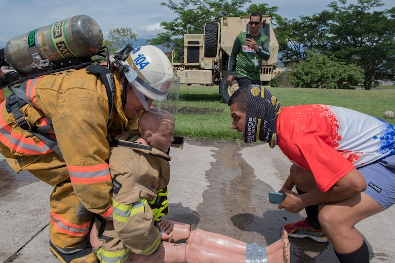 U.S. Air Force firefighters assigned to Joint Task Force Bravo's 612th Air Base Squadron train alongside firefighters from Belize, Guatemala, El Salvador, Honduras and Costa Rica during a multinational firefighting exercise at Soto Cano Air Base, Aug. 19-23, 2019. The Central America Sharing Mutual Operational Knowledge and Experiences exercise (CENTAM SMOKE) takes place twice a year and provides an opportunity for all firefighters to work as a team while learning from each other's capabilities through strenuous partnership-building challenges. (U.S. Air Force photo by Staff Sgt. Eric Summers)