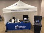 Table display with touch-screen voting machine and ballot scanner