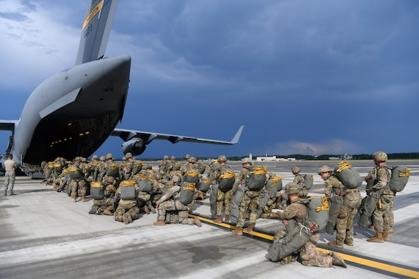 Paratroopers assigned to the 82nd Airborne Division board a Joint Base Charleston C-17 Globemaster III before performing a parachute assault exercise during Battalion Mobility Tactical Week at Fort Bragg, N.C., Aug. 19, 2019. Battalion Mass Tactical Week is a joint exercise involving the U.S. Air Force and the U.S. Army designed to enhance service members' abilities by practicing contingency operations in a controlled environment. The exercise incorporated three C-130J Super Hercules assigned to Little Rock Air Force Base, Arkansas, three C-17 Globemaster IIIs assigned to Joint Base Charleston, S.C. and Army paratroopers assigned to the 82nd Airborne Division of Fort Bragg, N.C. The exercise allowed all parties to quickly and safely complete training tasks, such as personnel and cargo air drops, to prepare joint forces to operate during global mobility missions.