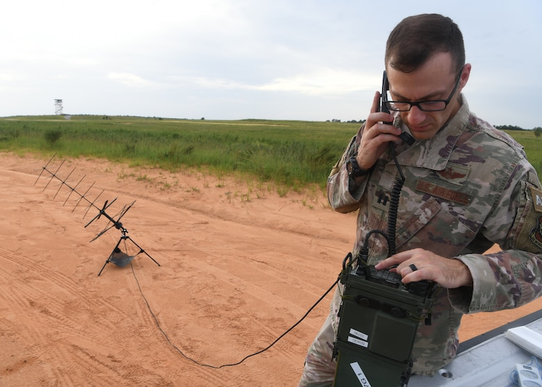 U.S. Air Force Capt. Peter Callo, an air mobility liaison officer assigned to the 621st Mobility Support Operations Squadron from Joint Base McGuire-Dix-Lakehurst, N.J., inspects communications equipment during Battalion Mobility Tactical Week at Fort Bragg, N.C., Aug. 20, 2019. Battalion Mass Tactical Week is a joint exercise involving the U.S. Air Force and the U.S. Army designed to enhance service members' abilities by practicing contingency operations in a controlled environment. The exercise incorporated three C-130J Super Hercules assigned to Little Rock Air Force Base, Arkansas, three C-17 Globemaster IIIs assigned to Joint Base Charleston, S.C. and Army paratroopers assigned to the 82nd Airborne Division of Fort Bragg, N.C. The exercise allowed all parties to quickly and safely complete training tasks, such as personnel and cargo air drops, to prepare joint forces to operate during global mobility missions.
