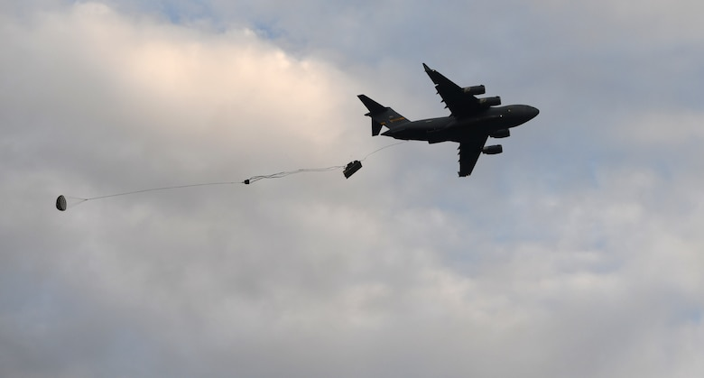 A Joint Base Charleston C-17 Globemaster III airdrops equipment onto a landing zone during Battalion Mobility Tactical Week at Fort Bragg, N.C., Aug. 20, 2019. Battalion Mass Tactical Week is a joint exercise involving the U.S. Air Force and the U.S. Army designed to enhance service members' abilities by practicing contingency operations in a controlled environment. The exercise incorporated three C-130J Super Hercules assigned to Little Rock Air Force Base, Arkansas, three C-17 Globemaster IIIs assigned to Joint Base Charleston, S.C. and Army paratroopers assigned to the 82nd Airborne Division of Fort Bragg, N.C. The exercise allowed all parties to quickly and safely complete training tasks, such as personnel and cargo air drops, to prepare joint forces to operate during global mobility missions.