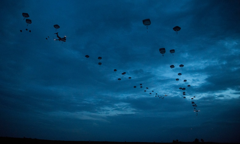 Joint Base Charleston C-17 Globemaster IIIs and C-130J Super Hercules assigned to Little Rock Air Force Base airdrop paratroopers onto a landing zone at lowlight conditions during Battalion Mobility Tactical Week at Fort Bragg, N.C., Aug. 20, 2019. Battalion Mass Tactical Week is a joint exercise involving the U.S. Air Force and the U.S. Army designed to enhance service members' abilities by practicing contingency operations in a controlled environment. The exercise incorporated three C-130J Super Hercules assigned to Little Rock Air Force Base, Arkansas, three C-17 Globemaster IIIs assigned to Joint Base Charleston, S.C. and Army paratroopers assigned to the 82nd Airborne Division of Fort Bragg, N.C. The exercise allowed all parties to quickly and safely complete training tasks, such as personnel and cargo air drops, to prepare joint forces to operate during global mobility missions.