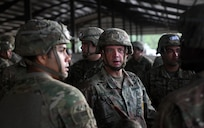 A paratrooper jump master assigned to the 82nd Airborne Division addresses his troops before taking part in fall exercises during Battalion Mobility Tactical Week at Fort Bragg, N.C., Aug. 19, 2019. Battalion Mass Tactical Week is a joint exercise involving the U.S. Air Force and the U.S. Army designed to enhance service members' abilities by practicing contingency operations in a controlled environment. The exercise incorporated three C-130J Super Hercules assigned to Little Rock Air Force Base, Arkansas, three C-17 Globemaster IIIs assigned to Joint Base Charleston, S.C. and Army paratroopers assigned to the 82nd Airborne Division of Fort Bragg, N.C. The exercise allowed all parties to quickly and safely complete training tasks, such as personnel and cargo air drops, to prepare joint forces to operate during global mobility missions.