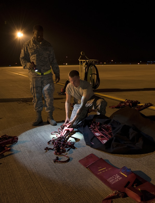 Senior Airman  Markeece Powell and Airman 1st Class Austin Sawchuk, B-2 Spirit crew chiefs assigned to the 509th Bomb Wing at Whiteman Air Force Base, Missouri, prepare covers for a B-2 Spirit after it landed at Royal Air Force Fairford, England, on Aug. 27, 2019. The Bomber Task Force deployment of the stealth bomber aircraft, Airmen and support equipment arrived in the U.S. European Command area of operations for a deployment to conduct theater integration and flying training. The deployment of strategic bombers to the United Kingdom helps exercise RAF Fairford as a forward operating base for the unit, ensuring they are engaged, postured and ready with credible force to assure, deter and defend the U.S. and its allies in an increasingly complex security environment. (U.S. Air Force photo by Staff Sgt. Kayla White)
