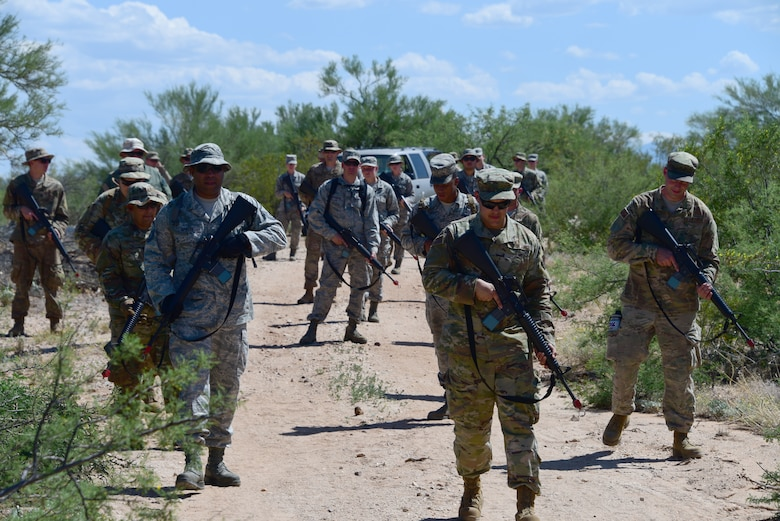 Airmen assigned to the 355th Maintenance Group practice tactical movement and communication during the first Field Expeditionary Combat Skills Training at Davis-Monthan Air Force Base, Arizona, Aug. 20, 2019. The 355th Security Forces Squadron worked in coordination with the MXG to ensure the readiness and ability of maintenance Airmen to be multi-functional so they can not only do their job, but defend the base and the assets of the Air Force in a near-peer fight. (U.S. Air Force photo by Airman 1st Class Jacob T. Stephens)