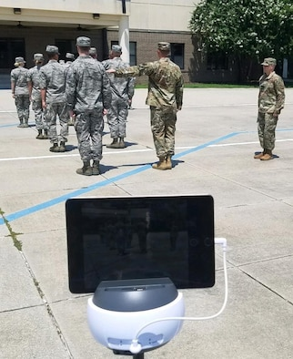 Military training leader course students conduct open ranks while using the Swivl video robot on Keesler Air Force Base, Mississippi, August 27, 2019. Swivl is a video robot designed to allow students to assess their own performance in the classroom, while increasing student engagement and supporting the Student-Centered Active Learning Environment with Upside-down Pedagogies learning model. Swivl gives students more ownership of their learning while reinforcing student interaction learning strategies: student-to-content, student-to-student, and student-to-instructor.