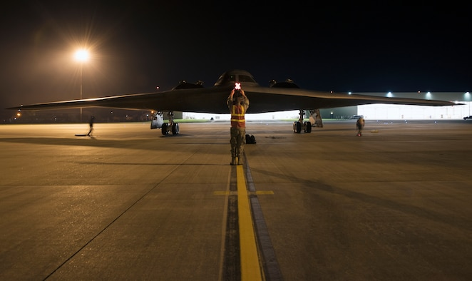 Airman 1st Class Austin Sawchuk, a crew chief assigned to the 509th Bomb Wing, marshals in a B-2 Spirit on the flightline at Royal Air Force Fairford, England, Aug. 27, 2019. A Bomber Task Force deployment of the B-2, Airmen and support equipment from Whiteman AFB arrived in the U.S. European Command area of operations for a deployment to conduct theater integration and flying training. The deployment of strategic bombers to the United Kingdom helps exercise RAF Fairford as a forward operating base for the unit, ensuring they are engaged, postured and ready with credible force to assure, deter and defend the U.S. and its allies in an increasingly complex security environment. (U.S. Air Force photo by Staff Sgt. Kayla White)
