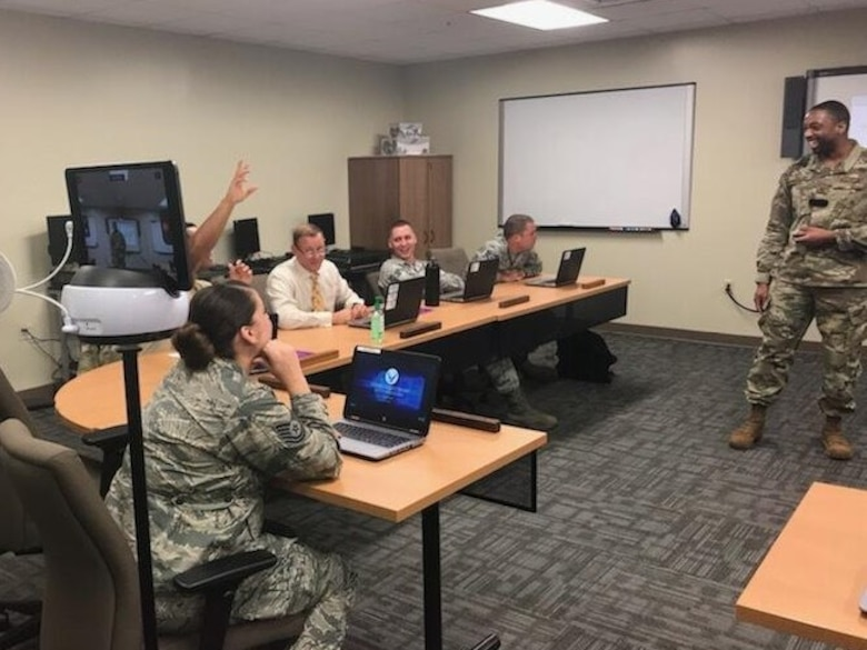A basic instructor course instructor conducts a lecture while using the Swivl video robot on Keesler Air Force Base, Mississippi, August 27, 2019. Swivl is a video robot designed to allow students to assess their own performance in the classroom, while increasing student engagement and supporting the Student-Centered Active Learning Environment with Upside-down Pedagogies learning model. Swivl gives students more ownership of their learning while reinforcing student interaction learning strategies: student-to-content, student-to-student, and student-to-instructor.