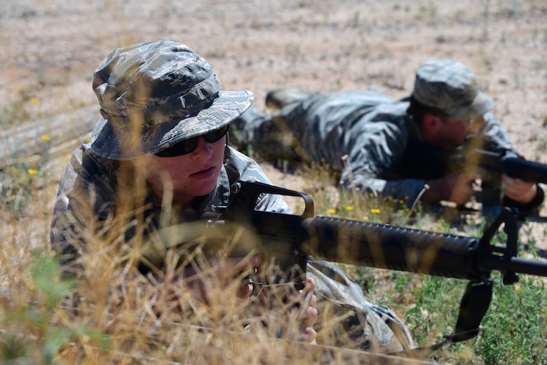Airmen assigned to the 355th Maintenance Group practice firing positions during the first Field Expeditionary Combat Skills Training at Davis-Monthan Air Force Base, Arizona, Aug. 20, 2019. Airmen engaged in hands-on training that included firing positions, hand and arm signals, as well as tactical movements. (U.S. Air Force photo by Airman 1st Class Jacob T. Stephens)