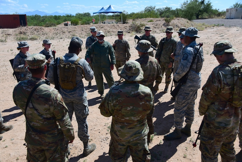 Airmen assigned to the 355th Maintenance Group receive instruction during the first Field Expeditionary Combat Skills Training at Davis-Monthan Air Force Base, Arizona, Aug. 20, 2019. The instruction covered the Law of Armed Conflict, Rules of Engagement and other material, as well as hands-on practice that included hand and arm signals, tactical movements and firing positions. (U.S. Air Force photo by Airman 1st Class Jacob T. Stephens)