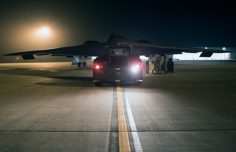 Crew chiefs assigned to the 509th Bomb Wing at Whiteman Air Force Base, Missouri, prepare a B-2 Spirit to be towed into a hangar at Royal Air Base Fairford, England, on Aug. 27, 2019. A Bomber Task Force deployment of B-2 Spirit stealth bomber aircraft, Airmen and support equipment from the 509th Bomb Wing at Whiteman AFB arrived in the U.S. European Command area of operations for a deployment to conduct theater integration and flying training. The deployment of strategic bombers to the United Kingdom helps exercise RAF Fairford as a forward operating base for the unit, ensuring they are engaged, postured and ready with credible force to assure, deter and defend the U.S. and its allies in an increasingly complex security environment. (U.S. Air Force photo by Staff Sgt. Kayla White)
