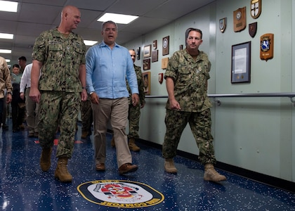 Colombian President Ivan Duque and military personnel walk together.