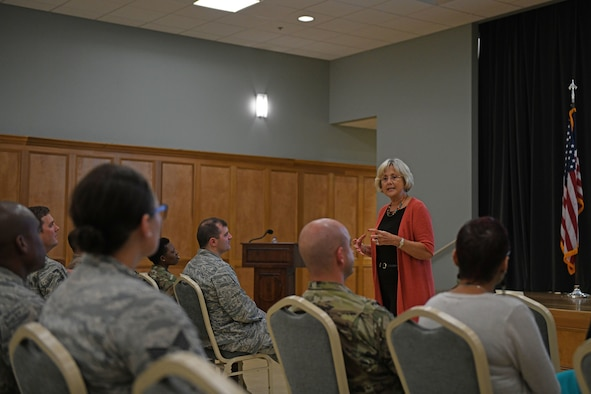 women talks to airmen