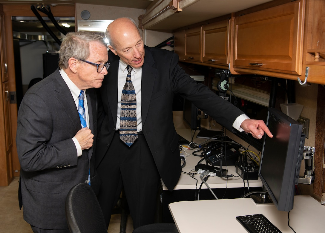 Arthur Huber, Air Force Research Laboratory deputy director of operations, shows Ohio Gov. Mike DeWine one of the monitors in the SkyVision recreational vehicle April 19, 2019 in a facility on the Springfield-Beckley Municipal Airport. DeWine was taking part in an announcement that the Federal Aviation Administration has granted a Certificate of Waiver or Authorization to the Air Force Research Laboratory for beyond visual line of sight flights of unmanned aerial systems. The system has been modified to be able to fit on a mobile platform. (U.S. Air Force photo by R.J. Oriez)
