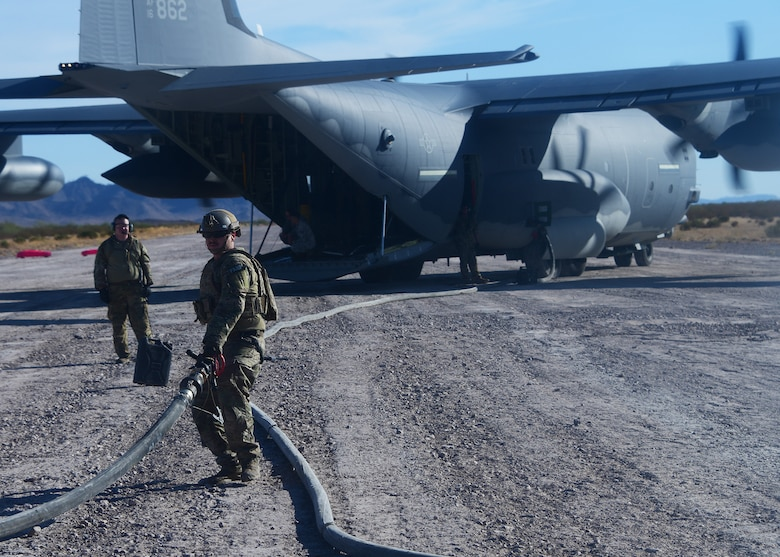A U.S. Air Force Forward Area Refueling Point operator finishes refueling a U.S. Navy MH-60S Seahawk during a training exercise in Southern Arizona that was involved in Red Flag-Rescue 19-2 on Aug. 21, 2019. FARP operators effectively refuel aircraft in remote locations when air-to-air refueling is not possible or when fueling stations are not accessible. (U.S. Air Force photo by Airman 1st Class Jacob T. Stephens)