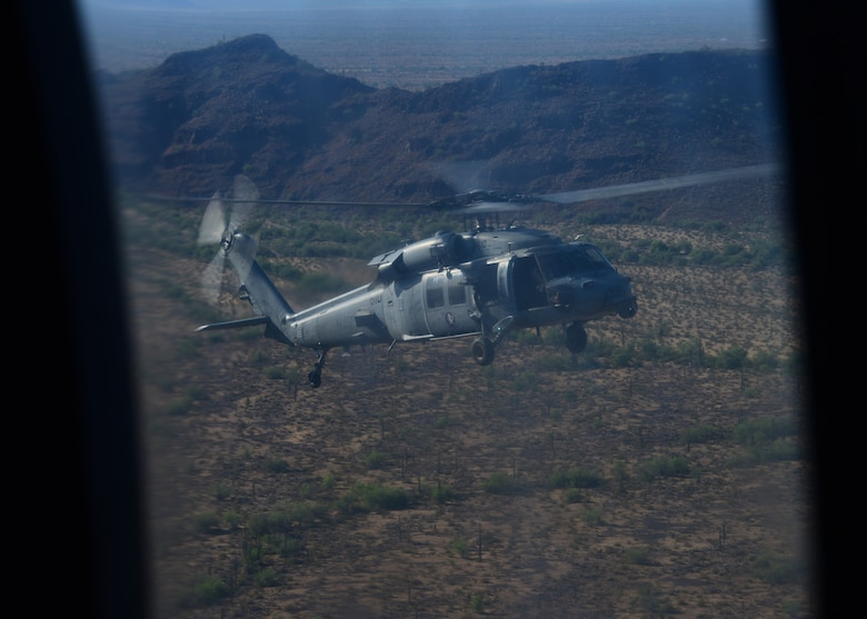 A U.S. Navy MH-60S Seahawk flies over Southern Arizona during a training exercise involved in Red Flag-Rescue 19-2 on Aug. 21, 2019. Red Flag-Rescue gives aircrews from across the Department of Defense the opportunity to complete their first 10 combat sorties. (U.S. Air Force photo by Airman 1st Class Jacob T. Stephens)