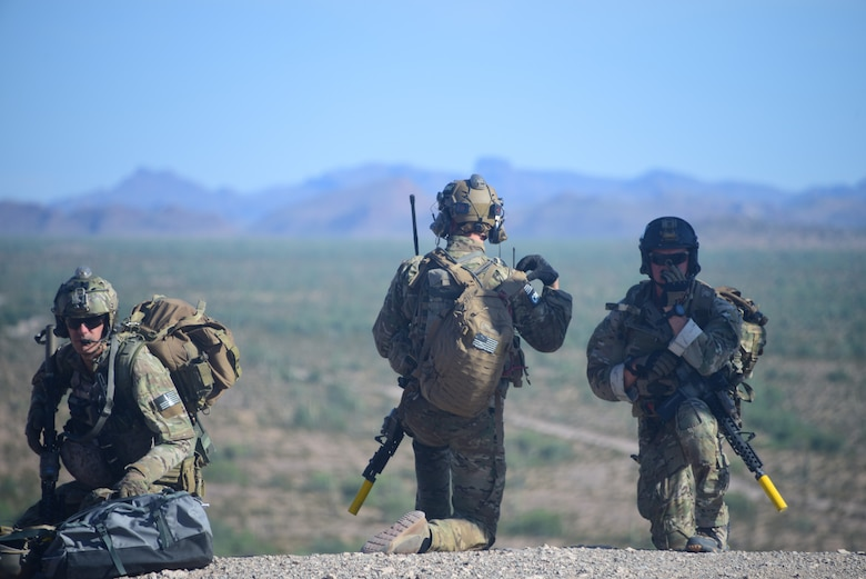 Simulated isolated personnel wait on recovery during an exercise in Southern Arizona as part of Red Flag-Rescue 19-2 on Aug. 21, 2019. Red Flag-Rescue is the Department of Defense's premier combat search and rescue exercise providing realistic combat search and rescue training in contested, degraded and operationally limited environments. (U.S. Air Force photo by Airman 1st Class Jacob T. Stephens)