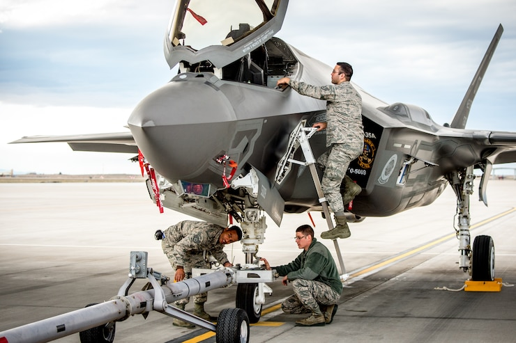 Aircraft maintainers, SSgt Thomas Stewart, left, Sr Airman Justin Wilmarth and SSgt Chris Mauldin, on ladder, prepare to tow an F-35A of the 31st Test and Evaluation Squadron, a tenant unit at Edwards Air Force Base, Calif., at Mountain Home AFB, Idaho, Feb 19, 2016. Six operational test and evaluation F-35s and more than 85 Airmen of the 31st TES travelled to Mountain Home AFB to conduct the first simulated deployment test of the F-35A, specifically to execute three key initial operational capability mission sets: suppression of enemy air defenses, close air support and air interdiction. (U.S. Air Force photo by J.M. Eddins Jr.)