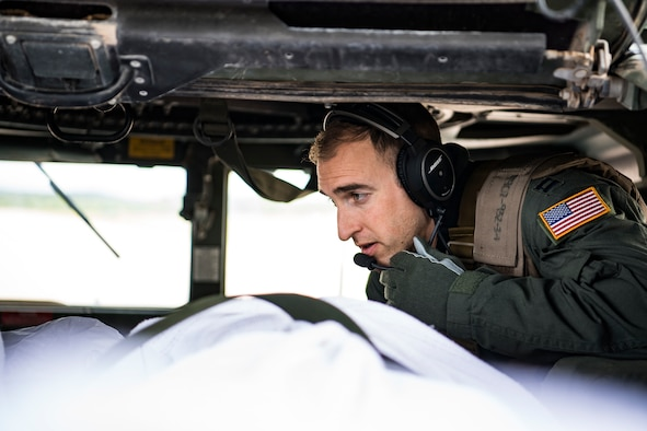 U.S. Air Force Capt. Tyler Relph, critical care aerial transport team registered nurse, manages patient movement during a training scenario as part of the Patriot Warrior exercise Aug. 16, 2019, at Fort McCoy, Wis. Patriot Warrior is Air Force Reserve Command's premier exercise providing Airmen an opportunity to train with joint and international partners in airlift, aeromedical evacuation, and mobility support. The exercise builds on our capabilities for the future fight, increasing the readiness, lethality and agility of the Air Force Reserve. (U.S. Air Force Photo by Tech. Sgt. Gregory Brook)
