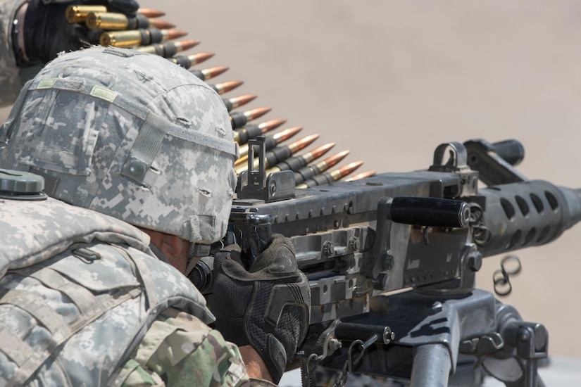 Oregon Army National Guard Sgt. Bobby Cornelious shoots an M2 machine gun during a live fire exercise (LFX) at Naval Weapon Systems Training Facility (NWSTF), Boardman, June 23.