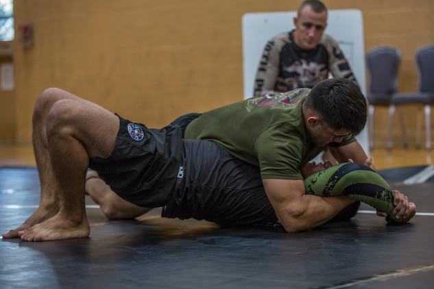 U.S. Marines stationed at Marine Corps Air Station (MCAS) Yuma and civilians from the Yuma community, participate in the Semper Fit Grappling Tournament at the station gym, August 23, 2019. The tournament consisted of four different catoregories based off weight and experience level. (U.S. Marine Corps photo by Cpl. Sabrina Candiaflores)