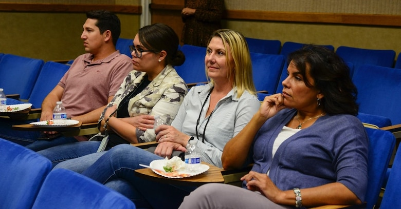 Members of Team Kirtland watch various 'TED' talks during the Women's Equality Day event at Kirtland Air Force Base, N.M., August 26, 2019.  In 1973, Congress officially designated August 26 as Women's Equality Day to commemorate the 1920 adoption of the 19th amendment of the U.S. constitution, making it illegal to deny citizens the right to vote based on their gender. (U.S. Air Force photo by Senior Airman Alexandria Crawford)